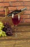 Bottle of  wine in a basket. Royalty Free Stock Image