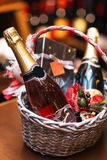 Bottle of wine in basket. Gift for holiday royalty free stock image