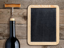 Bottle of wine and blank blackboard royalty free stock photo