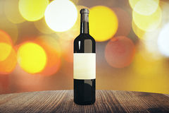 Bottle of wine. Wine bottle with blank label on wooden table, with blurry lights in the background. Mock up, 3D Rendering Royalty Free Stock Photos