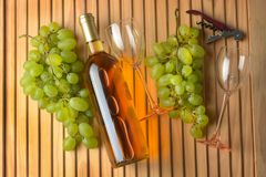 Bottle of wine, bunch of grapes, glasses of glass Royalty Free Stock Image