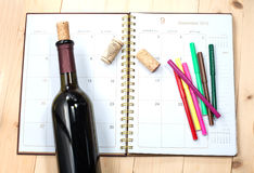 Bottle of wine on calendar royalty free stock photos