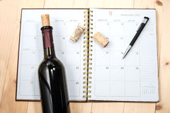Bottle of wine on calendar royalty free stock photography