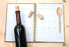 Bottle of wine on calendar royalty free stock photo