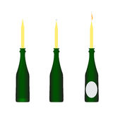 Bottle of wine with candles Stock Photos