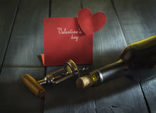 Bottle of wine with a card Happy Valentine`s Day Stock Image