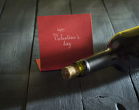 Bottle of wine with a card Happy Valentine`s Day Royalty Free Stock Photo