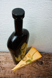 Bottle of wine and cheese on the background wall Royalty Free Stock Photo