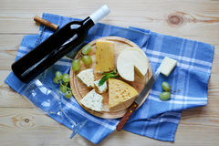 A bottle of wine and cheese. Royalty Free Stock Images