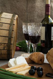 Bottle of wine, cheese and white bread are on sacking. Bottle of wine, olives, cheese and white bread are on sacking Royalty Free Stock Photos