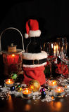 Bottle of wine in Christmas attire Stock Photos