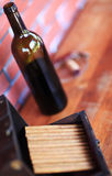 Bottle of wine and cigars Royalty Free Stock Photos