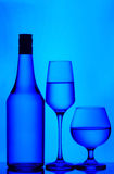 Bottle, wine and cognac glasses Royalty Free Stock Images