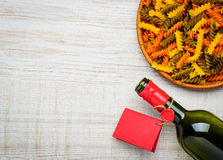 Bottle Wine, Colored Fusilli Pasta and Copy space Royalty Free Stock Photo