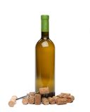 A bottle of wine, corks and corkscrew. A bottle of wine, corks and corkscrew isolated on the  white background Royalty Free Stock Photo