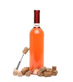 A bottle of wine, corks and corkscrew. A bottle of wine, corks and corkscrew isolated on the  white background Royalty Free Stock Photography