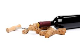 Bottle of wine, corks and corkscrew. Royalty Free Stock Photo