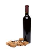 Bottle of wine, corks and corkscrew. Royalty Free Stock Images