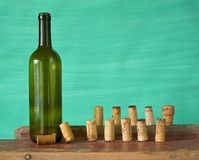 Bottle of wine, corks Royalty Free Stock Images