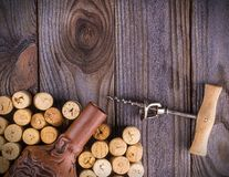 The bottle of wine with corks on wooden table background.  royalty free stock photos
