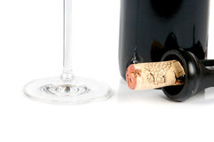Bottle of wine and a corkscrew. On white background Stock Photos