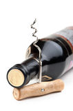 Bottle of wine and a corkscrew Royalty Free Stock Photo