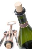 Bottle of wine and corkscrew. On a white Royalty Free Stock Image