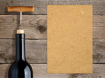 Bottle of wine with corkscrew and blank paper Royalty Free Stock Photography