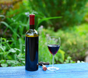 Bottle of wine with corkscrew and glass Stock Photo