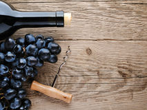 Bottle of wine, corkscrew and grape Royalty Free Stock Photo