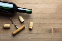 Bottle of wine and a corkscrew Royalty Free Stock Photos