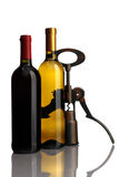 Bottle of wine with corkscrew on white Royalty Free Stock Images