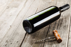 Bottle of wine and corkscrew Stock Photography