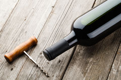 Bottle of wine and corkscrew Stock Photos