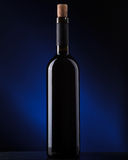 A bottle of wine on a dark background Royalty Free Stock Photo