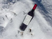 Bottle of wine deposited in the snow stock photos