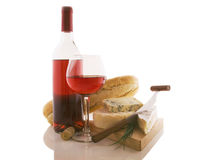 A bottle of wine with different kind of cheeses Royalty Free Stock Photography