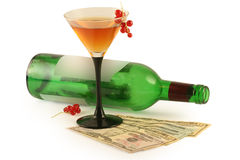 Bottle of wine and dollars Royalty Free Stock Photo