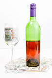 Bottle of wine,dollars and glass Stock Images