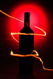 Bottle of wine with flames Royalty Free Stock Photo