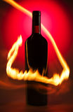 Bottle of wine with flames Royalty Free Stock Images