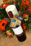 Bottle of wine with flower decoration Royalty Free Stock Photos
