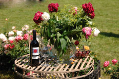 Bottle wine and flowers. Flowers and a bottle of red wine in the garden Stock Image