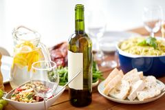 Bottle of wine and food on served wooden table Royalty Free Stock Images