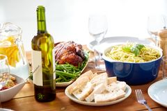 Bottle of wine and food on served wooden table Stock Photography