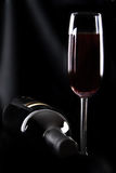 Bottle of wine and glass. On black background Royalty Free Stock Photos