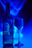 Bottle of wine and glass Stock Images