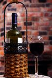 A bottle of wine and a glass Stock Photos