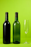 Bottle of wine and glass. On green background Royalty Free Stock Photography