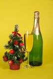 Bottle and wine glass with champagne Royalty Free Stock Photography